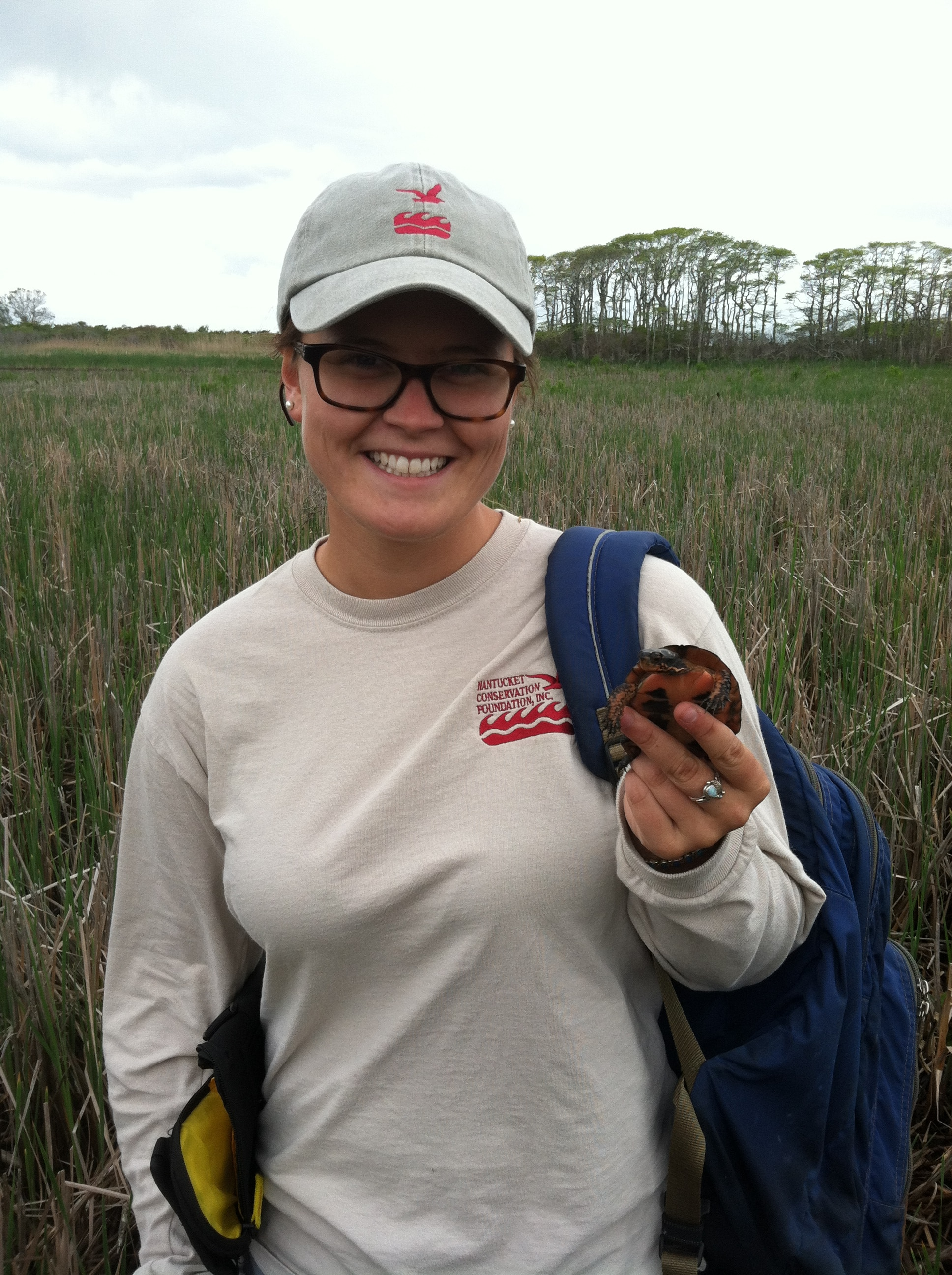 Sara holding a painted turtle found at Medouie